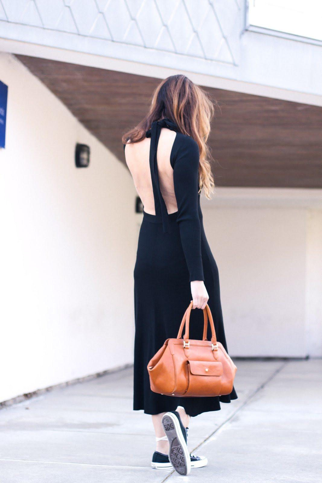 vestido negro escote espalda y doctor bag